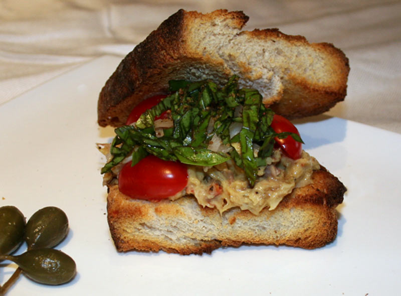 Smoked Mackerel salad with tomatoes and basil sandwich