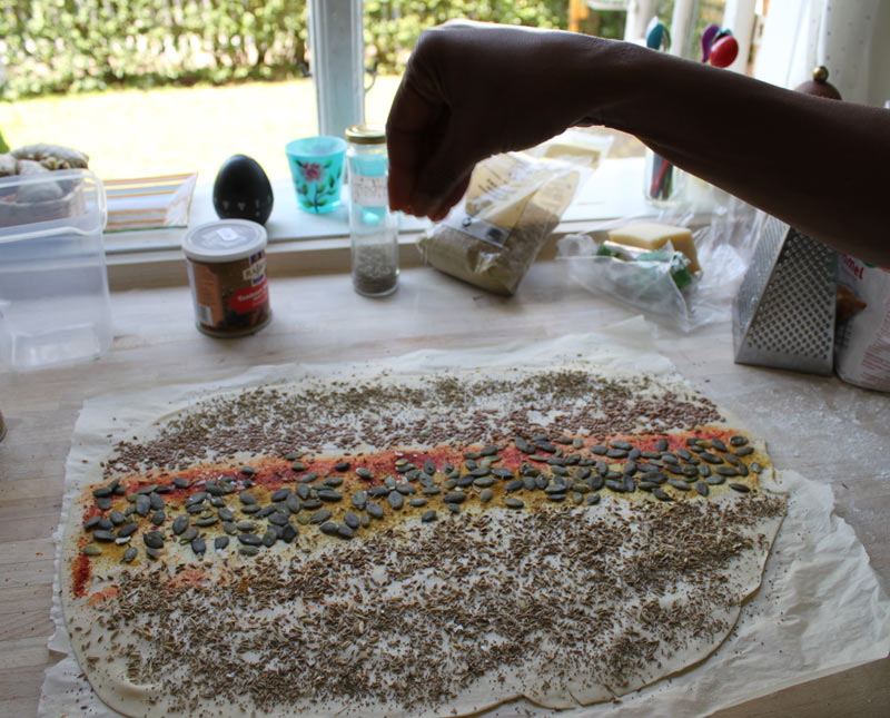 Adding spices and Seeds to the lavash crackers