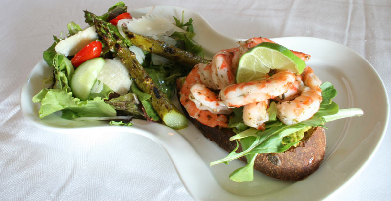 Cilantro lemon shrimp sandwich on guacamole with a side of asparagus parmasan salad