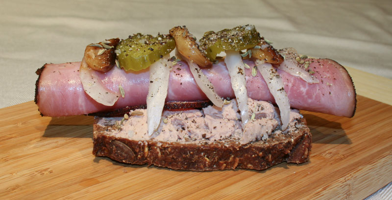 Liver Pate sandwich with ham, onions, roasted garlic, sweet pickles, and pepper