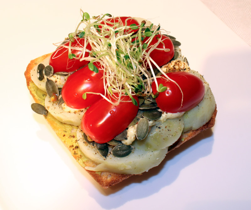 Potato ciabatta roll with pumpkin seeds and grape tomatoes