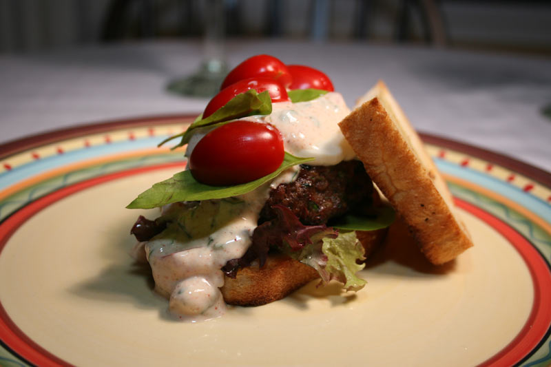 Cheese Kafta Burger with Grape Tomatoes, Roasted Garlic, Olive Oil, Thai Basil, Grape Tomatoes and Spicy Light Yogurt Dressing