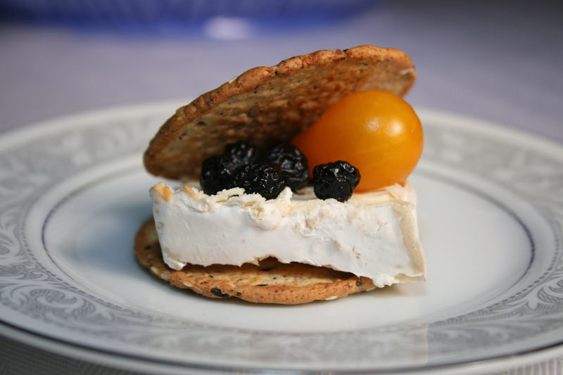 "Saint Faron Cheese Cracker ""Sandwich"" with Blueberries and Yellow Pear Tomato"