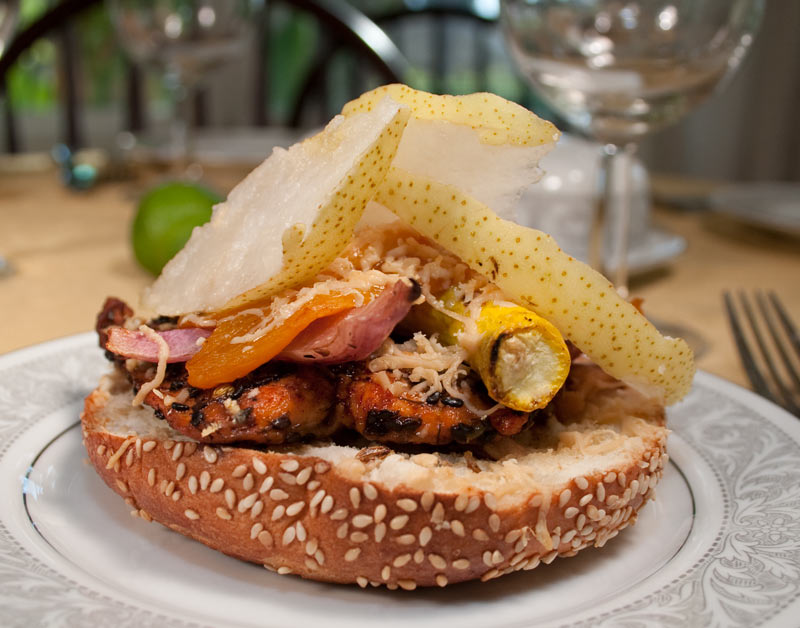 The Ultimate Seared Salmon Sandwich on a Sesame Bagel with Roasted Garlic, Roasted Vegetables, Shredded Primadonna Cheese and Pear