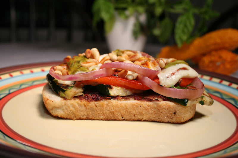 Veggie Sandwich with Roasted Zuchini, Mustard, Olive Oil, Olive Tapenade, Roasted Bell Peppers, Pecorino Romano Cheese, Paprika and Tarragon Mustard