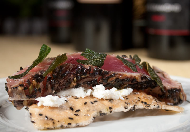 "Sesame Tuna Appetizer with Ricotta Cheese, Sage Infused Olive Oil and Fried Sage Leafs on ""Banh Da"" bread"