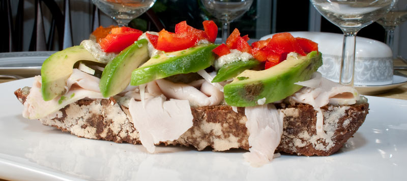 Turkey Sandwich with Creamy Garlic Paste, Avocado, Red Bell Pepper and Onion.