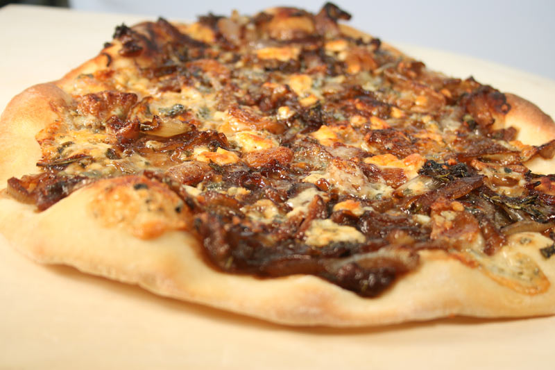 Caramelized Onion Pizza with Roquefort and Roasted Garlic and Pesto-Mascarpone Sauce