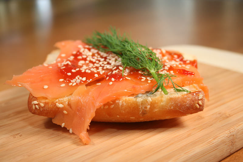 Ciabatta Sandwich With Smoked Salmon, Valdeon Cheese, Sesame Seeds And Tomato Relish