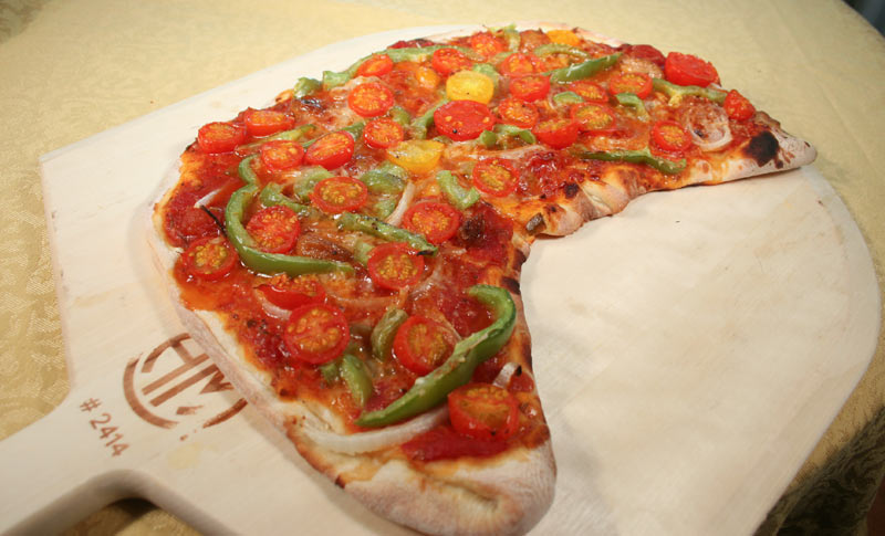 Half-Moon Vegetable Pizza with Green Peppers, Grape Tomatoes and Onion