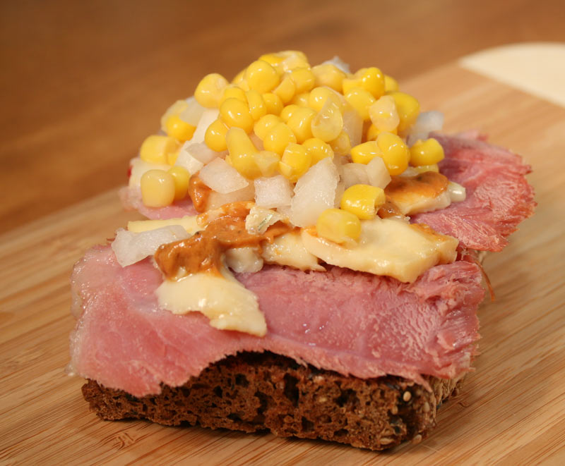Jamaican Christmas Ham with Danish Cheese, Tomato Vodka Mustard, Diced Onions, and Corn