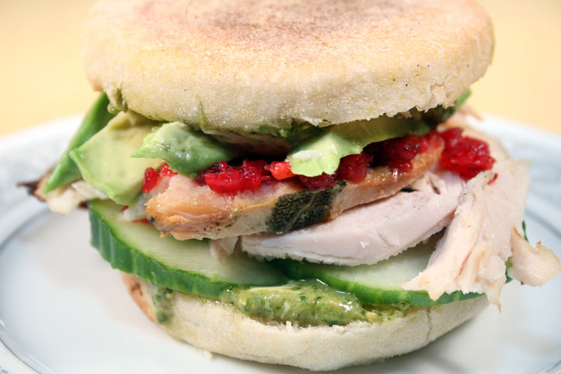 Turkey Sandwich On An English Muffin With Mascarpone-Pesto, Cucumber, Cranberry Relish and Avocado