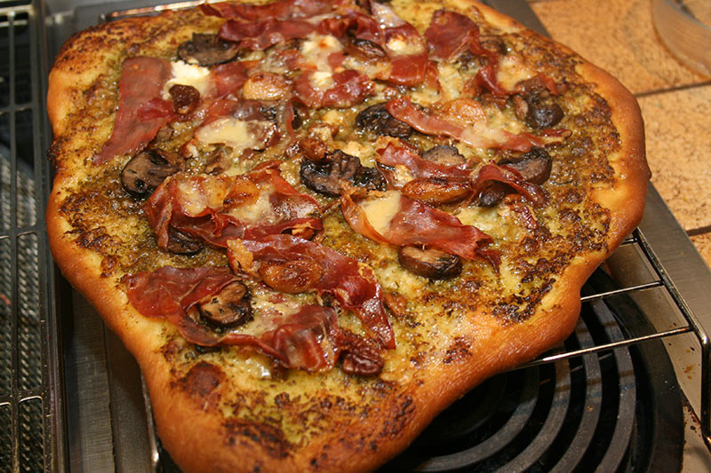 Pizza: Prosciutto, Sauteed Garlic Mushrooms, Rembrandt Gouda Cheese, Mascarpone/Pesto Cheese, Roasted Garlic, Goat Cheese