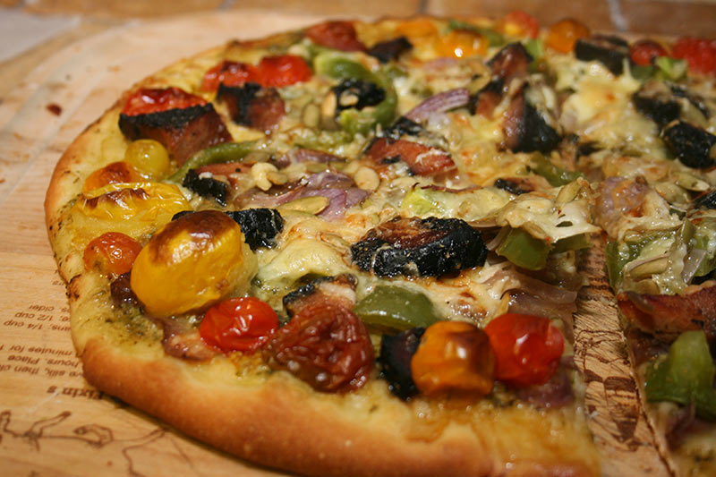 Pizza: Black Forest Ham, Onions, Heirloom Tomatoes, Sauteed Garlic Mushroom, Jarlsberg/Parmasan Cheese, Peperino Seeds (pumpkin), Tomato Sauce, Roasted Garlic