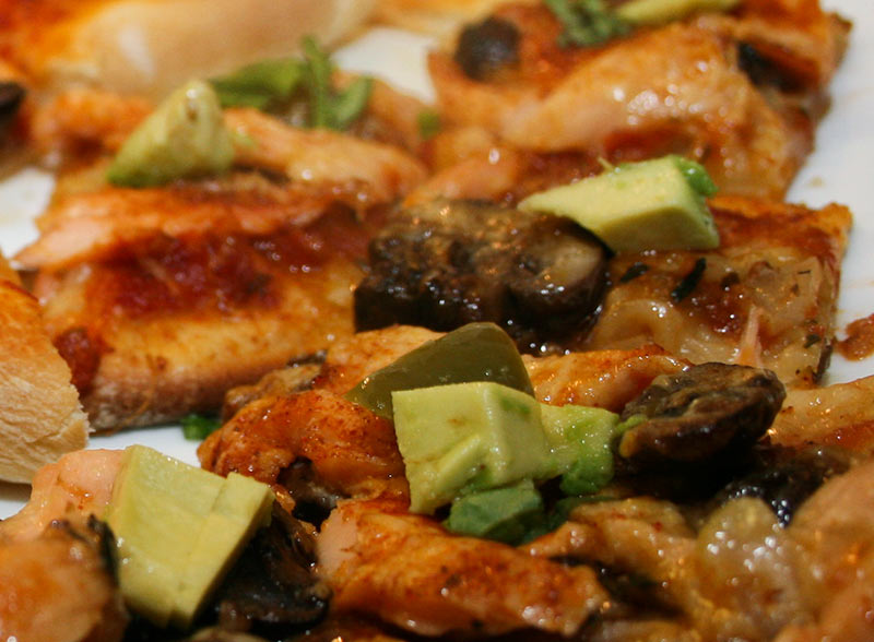 Smoked Salmon Pizza With Sautéed Garlic Mushrooms, Tomato Sauce, Avocado, Jarlsberg Cheese And Fresh Basil