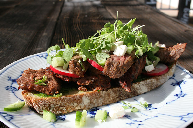 Sandwich With Carne Asada, Cucumber, Feta, Cherry Vinegar, And Radishes