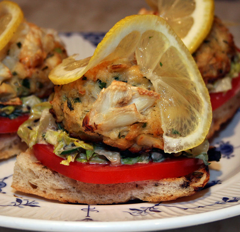 Crab cake Sandwich: Oven Roasted Focaccia With Crab cake, Roasted Garlic, Lettuce and Lemon